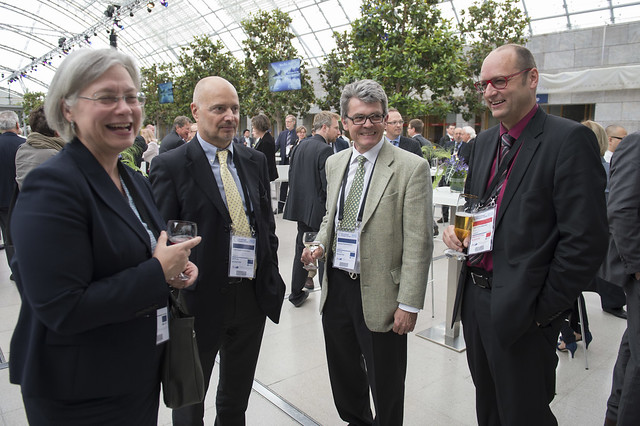 Jean-Claude Schneuwly, Matthias Rinderknecht and Jürg Röthlisberger share a drink at the reception