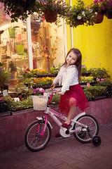 IMG_7367 (D-Ulia) Tags: city flowers sunset sun streets girl smile kids backlight fun spring twilight little blossom bokeh walk backlit walkaround bycicle