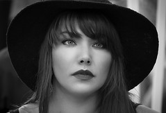 Hat Girl Walk By Portrait (Jim-Mooney) Tags: street portrait people blackandwhite bw white black monochrome photography mono blackwhite fuji monotone kansascity crossroads fujinon xt1 50140mm