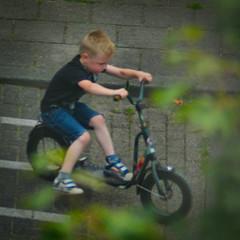 Scooter Kid (Arthur Koek) Tags: boy sitting pushscooter road harderwijk veluwe gelderland thenetherlands