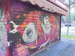 brazilian style! (en-ri) Tags: dico dms orey tizio guy uomo man pesce fish grigio arancione nero bologna wall muro graffiti writing serranda chiosco