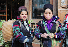 Hmong women in Sapa (phuong.sg@gmail.com) Tags: travel pink portrait people woman baby black tourism senior smile field hat rural standing asian asia vietnamese hand market traditional famous rustic chinese earring indigo culture scene tribal vietnam clothes thai destination local cloth oriental northern ethnic minority sapa hmong authentic peasant ethnicity