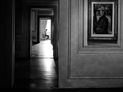 untitled . (helmet13) Tags: light bw italy woman museum painting florence doors exhibition silence museumattendant aoi palazzopitti 100faves peaceaward heartaward world100f platinumpeaceaward worldpeacehalloffame leicaxvario