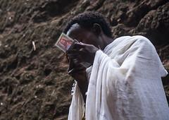 Ethiopian orthodox man kissing his bible, Amhara region, Lalibela, Ethiopia (Eric Lafforgue) Tags: africa people man color men horizontal outdoors photography reading book kiss kissing adult african faith religion praying christian unescoworldheritagesite celebration devotion bible christianity shawl spirituality ethiopia orthodox religiouscelebration coptic pilgrim oneperson traditionalculture lalibela hornofafrica eastafrica thiopien etiopia abyssinia ethiopie traditionalclothing etiopa onlymen onemanonly waistup lowangleview  etiopija 1people ethiopi  africanculture etiopien etipia  etiyopya  amhararegion         semienwollozone ethio161411