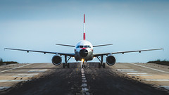 Landed (Nicola Pezzoli) Tags: travel summer airplane landscape island airport zoom aircraft greece airbus airlines runway landed skiathos austrian