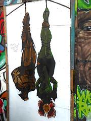 Hangin' about (Draopsnai) Tags: urban streetart graffiti cartoon shoreditch batman fencing