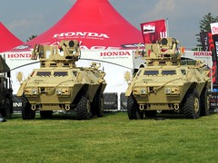 I wonder if Honda makes American tanks? (kennethkonica) Tags: red people usa white color men green america canon honda women midwest random indianapolis rando indy indiana nationalguard racers tanks drivers speedway irl canonpowershot indycar militaryvehicles indianapolis500 presidentobama gocpence