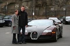 Larry and his Wife with a Bugatti Veyron
