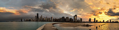 Chicago sunset - Explore (Kevin Povenz) Tags: city blue sunset shadow orange sun chicago storm reflection beach water rain weather yellow clouds buildings evening pier spring midwest downtown glow cityscape shadows skyscrapers outdoor dusk pano wideangle stormy panoramic lakemichigan april curve sunlit stormyweather lookingwest northavenuebeach windycity 2016 illinios canon7dmarkii kevinpovenz