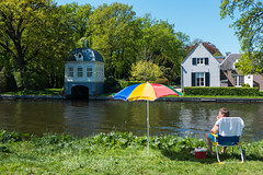 A tale of two worlds (PaulHoo) Tags: life holland reflection building water netherlands architecture river lumix spring parasol recreation teahouse vecht 2016