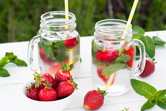 Cold drink with mint and strawberry (nadiaborovenko) Tags: red summer food cold tree green ice nature water glass grass closeup fruit table frozen leaf healthy strawberry berries drink sweet outdoor eating juice beverage mint straw cider nobody fresh lemonade cocktail homemade slice mojito citrus portion punch liquid herb assorted freshness detox refreshment ingredient