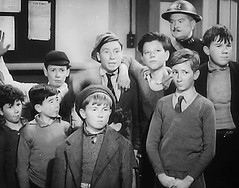 Who ate all the oranges (theirhistory) Tags: uk london film boys kids children war wwii kinderen crime jacket cap gb ww2 jumper 1942 warden adults villians bfilm johntacchi