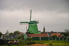 Like an old Dutch painting (angelsgermain) Tags: houses summer sky storm green tower netherlands windmill grass clouds landscape northholland zaanseshans