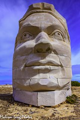 Head sculpture on cliff top at Elliston Eyre Peninsula South Australia (Malcom Lang) Tags: sky sculpture painterly face grass stone clouds canon out outside outdoors nose graffiti eyes weeds rocks outdoor stones south australia ground carving lips southern dirt blocks aussie peninsula effect southaustralia limstone elliston eyre canonef canonef2470mm canon6d canoneos6d malcomlang malcomlangphotos