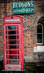 British Phone Box (Adrian Evans Photography) Tags: old uk red abandoned window sign vintage buildings bench rust peeling arch outdoor decay seat telephone victorian icon worn disused british phonebox memorabilia dilapidated textured redphonebox hudsons greensign supersoap currantred