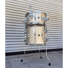 "Here's a great little cocktail kit for @scottquintana. 15"" 6 ply maple shells with 6 ply reinforcement rings, wrapped in Silver Glass Glitter. Top drum is an 8X15 snare drum and the bottom is a 12X15 bass drum. Can't wait to hear him play this with @Space"