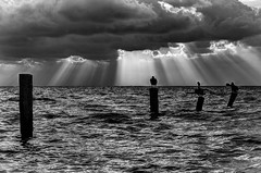 Morning clouds (bgauger14) Tags: ocean travel light sea blackandwhite water birds clouds sunrise landscape mexico coast rays pilings lightrays