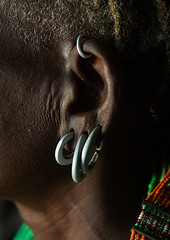 Close up of toposa tribe woman earrings, Omo valley, Kangate, Ethiopia (Eric Lafforgue) Tags: africa people color vertical outdoors necklace women day adult african traditional decoration jewelry tribal indoors blackpeople omovalley earrings ethiopia tribe ethnic cultural oneperson jewel developingcountry ethnicity hornofafrica ethiopian eastafrica abyssinia traditionalclothing realpeople blackskin beadednecklace bume onewomanonly 1people indigenousculture africanculture ethnicgroup toposa bodyadornment topossa kangate blackethnicity ethiopianethnicity kangatan ngakaaly ethio161664