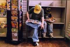 No reading before purchase (Tim Brown's Pictures) Tags: washingtondc dupontcircle bookstore comics comicbooks boys children reading timbrown 2000 baseballcaps caps