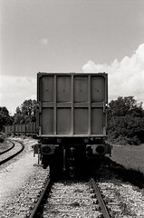 Industry Train (Ferdinand Klotzky) Tags: black and white canon a1 fd 50mm f18 kodak trix 400 35mm film classic retro negative self developed made germany augsburg aerospace true style look train railroad industry container vintage