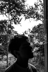 Cigarette smoke in yours eyes (gustavoolt) Tags: silhouette blackwhite nikon cigarette smoke cigarettesmoke