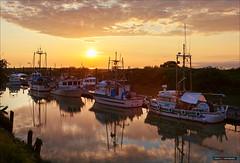 Sundown Over The Fleet (Clayton Perry Photoworks) Tags: sunset canada vancouver clouds reflections boats spring fishing bc richmond garrypointpark scotchpond explorebc explorecanada vancitybuzz
