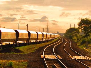 Coal Trucks In The Setting Sun