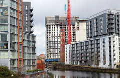 Constructions (Katrinitsa) Tags: street city uk greatbritain bridge houses windows red england sky streets building green water colors architecture canon buildings river walking manchester living site spring construction europe cityscape view riverside unitedkingdom britain crane towers streetphotography works waters british tall castlefield riverview skyview constructions irwell