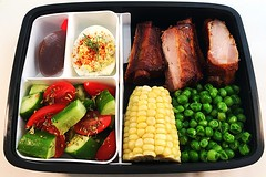 Riblet Bento (Cathryn3) Tags: tomato lunch salad corn cucumber bbq ribs peas bento caribbean balsamic deviledeggs