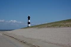 The lighthouse (II) (dididumm) Tags: blue sky lighthouse holland beach netherlands sunshine strand spring dune himmel zeeland northsea blau dyke nordsee dike leuchtturm dne frhling niederlande levee sonnenschein deich breskens