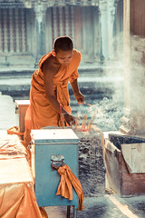 Praying (Gigin - NoDigital) Tags: boy people orange nature fruits fog buildings temple other kid asia cambodia monk places angkorwat geography activity angkor wat locations