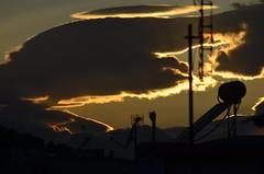 Nostalgia (iOLAos_) Tags: light sunset sky urban orange sun clouds dawn nostalgia romantic antenna