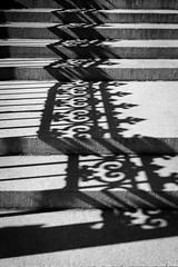 Railing Shadows (Howard_L) Tags: bw usa newyork 35mm mono shadows sony steps places northamerica a7r sonya7r