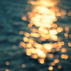 Golden sunlights on blue water background. (ManhDesign.Inc) Tags: road christmas travel blue light sunset red sea summer vacation sky orange sun sunlight white abstract color reflection texture nature water beautiful beauty yellow glitter season lights golden shiny waves pattern shine bright bokeh background seasonal decoration blurred sparkle gleam glowing blink textured defocused luminosity