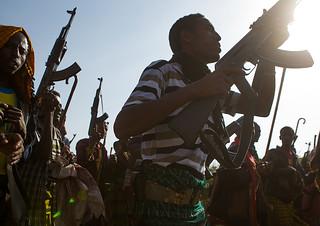 Oromo men with kalashnikovs during a wedding celebration, Oromo, Sambate, Ethiopia