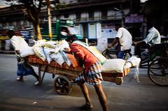 Fast Lane (Soumya Mukherji) Tags: streets workers goods cart chandnichowk olddelhi toil