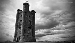 Broadway Tower (Simon Woodward Photography) Tags: sky blackandwhite tower monochrome skyline architecture clouds moody outdoor broadway column cotswold simplysuperb