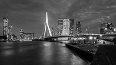 Rotterdam Connection (McQuaide Photography) Tags: city longexposure nightphotography bridge light blackandwhite bw holland reflection water netherlands monochrome dutch skyline architecture night photoshop canon river eos mono licht blackwhite lowlight rotterdam europe riverside nacht availablelight widescreen tripod nederland wideangle panoramic drawbridge brug fullframe dslr 169 kopvanzuid 1740mm modernarchitecture erasmusbrug manfrotto lightroom 6d zuidholland rivier nieuwemaas erasmusbridge wideanglelens lseries benvanberkel basculebridge dezwaan canon6d groothooek mcquaidephotography