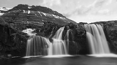 Inside the Gates of Eden (lunaryuna) Tags: longexposure bw panorama mountain nature monochrome beauty season landscape coast blackwhite waterfall iceland spring solitude ngc textures le lunaryuna stillness kirkjufell westiceland seasonalchange lwater kirkjufellsfosswaterfall