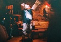 Mr. L. (De Luca Sara) Tags: krakow man mr karaoke night orange drink vodka analog analogica nikon photo