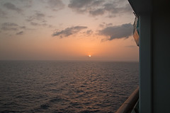 sunset from our cabin (jimbobphoto) Tags: ocean cruise sunset orange water clouds ship balcony royalcaribbean oftheseas