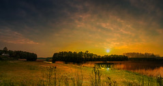 Sunset. (augustynbatko) Tags: sunset sky sun lake nature clouds landscape meadow