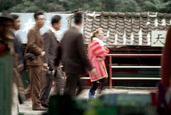 32-865 (ndpa / s. lundeen, archivist) Tags: nick dewolf nickdewolf 32 reel32 color photographbynickdewolf 1970s 1972 fall film 35mm winter republicofchina taiwan taiwanese china chinese wulai wulaidistrict newtaipei atayal atayalvillage aboriginalvillage atayalaboriginalvillage people aborigine woman clothes clothing traditionalclothing hat headdress men suits oldwoman tattoo facialtattoo visitors tourists 1973