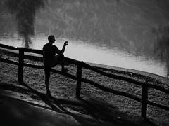Take a picture of the lake (un2112) Tags: man human belapatfalva bélapátfalva countryside lake august morning monochrome bw blackandwhite panasonicg7 dew vapour phone silhouette