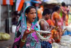 Need a break (Rajib Singha) Tags: street travel portrait people woman india flower interestingness searchthebest garland trade kolkata westbengal nikond200 mallikghatflowermarket mfnikkor50mmf14aislens