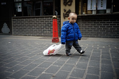 110515-0007 (jpfpreston) Tags: street leica people london 35mm shopping bag drag photography chinatown child joshua sony streetscene summicron preston f2 todler dragging a7r
