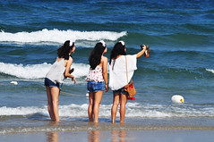 A selfie in the surf (Roving I) Tags: travel friends sea tourism beach photography surf longhair posing tourists vietnam headbands danang smartphones selfies jeansshorts ilobsterit