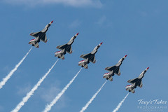 Five Thunderbirds lined up abreast