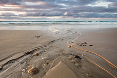 Outlet (Andrew Paul Watson) Tags: uk light sunset shadow sea sky seascape seaweed clouds landscape scotland sand rocks long exposure stones scottish pebble fujifilm moray firth lossiemouth