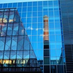 Evening Reflections (nl042) Tags: docklands chimney reflection reflections plateglass contrasts dublin grandcanaldock